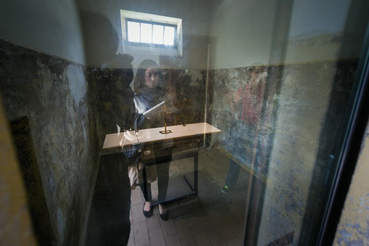 reflective in front of a prison cell in the concentration camp Dachau